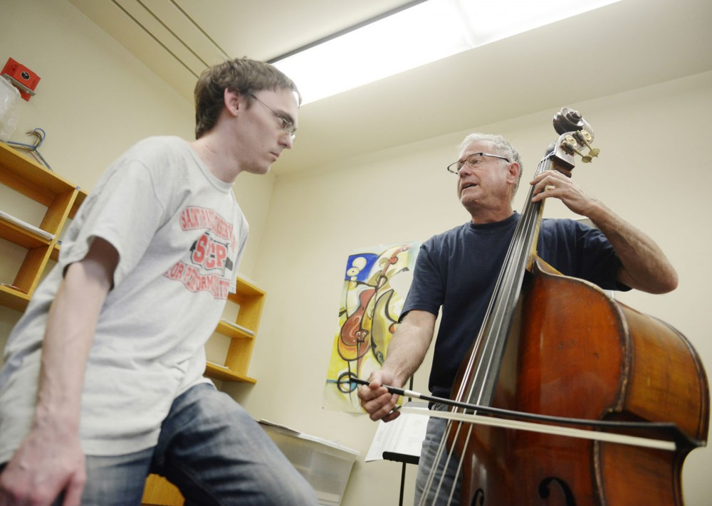 St. Paul Conservatory for the Performing Arts PSEO student Tiller Martin receives a bass lesson from adjunct faculty instructor of double bass Christopher Brown on Tuesday, April 30, 2013, in Ferguson Hall.