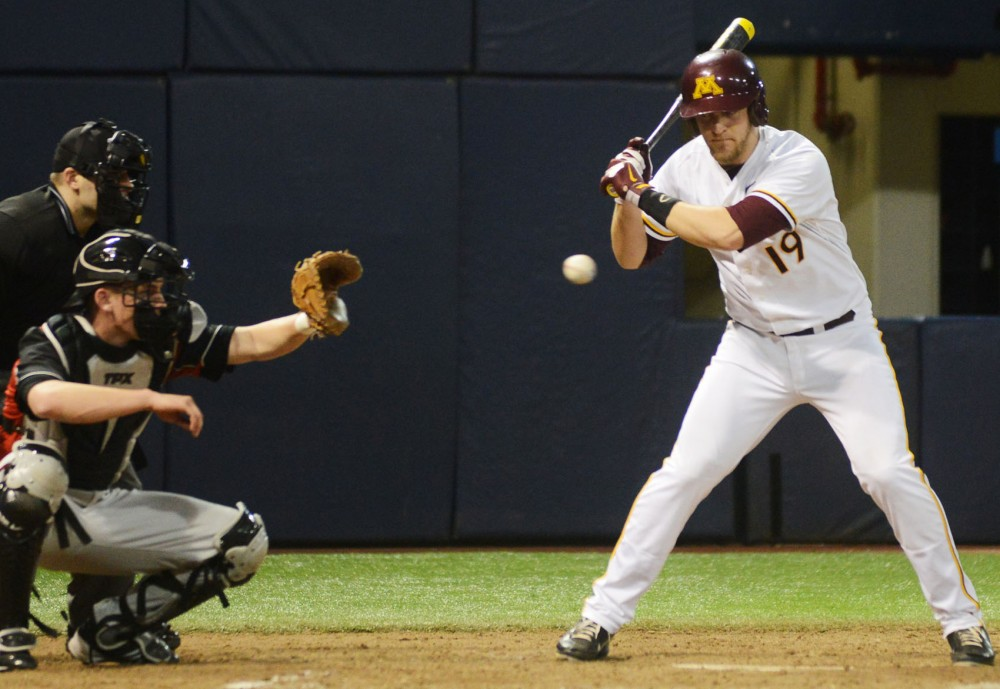 Minnesota infielder Ryan Abrahamson takes a pitch Tuesday, March 12, 2013, at the Metrodome.