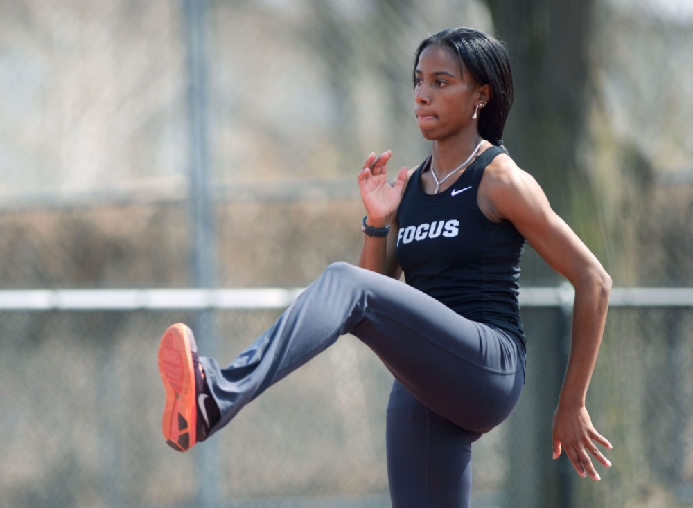 Minnesota's mid-distance runner Alena Brooks warms up before practice on Monday, May 6, 2013, at Bierman Field.