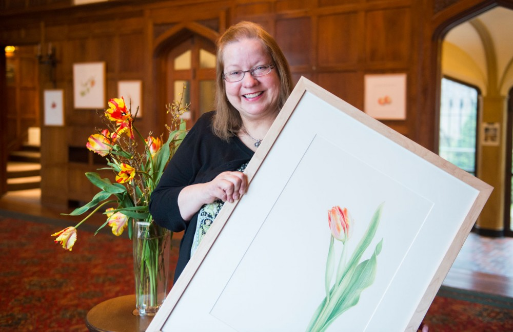 Founder of the Minnesota School of Botanical Art Marilyn Garber holds one of her own pieces of art in The Bakeen Museum where the museum will have the