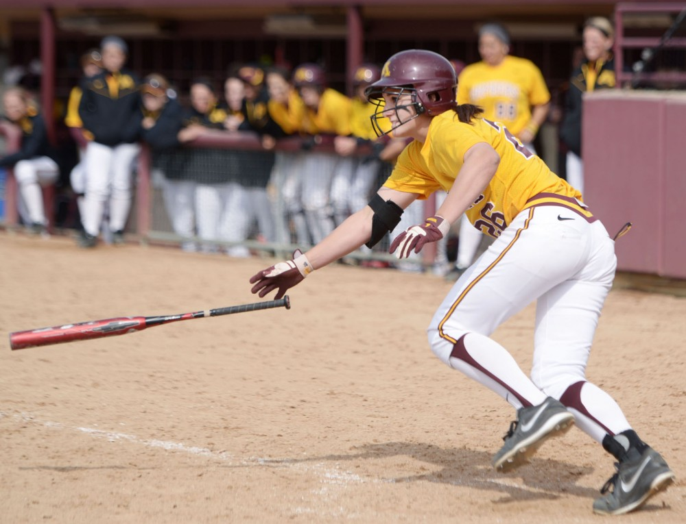 Minnesota's Kaitlyn Richardson throws her bat after a base hit during a doubleheader against Wisconsin on Sunday, April 7, 2013, at Jane Sage Cowles Stadium.
