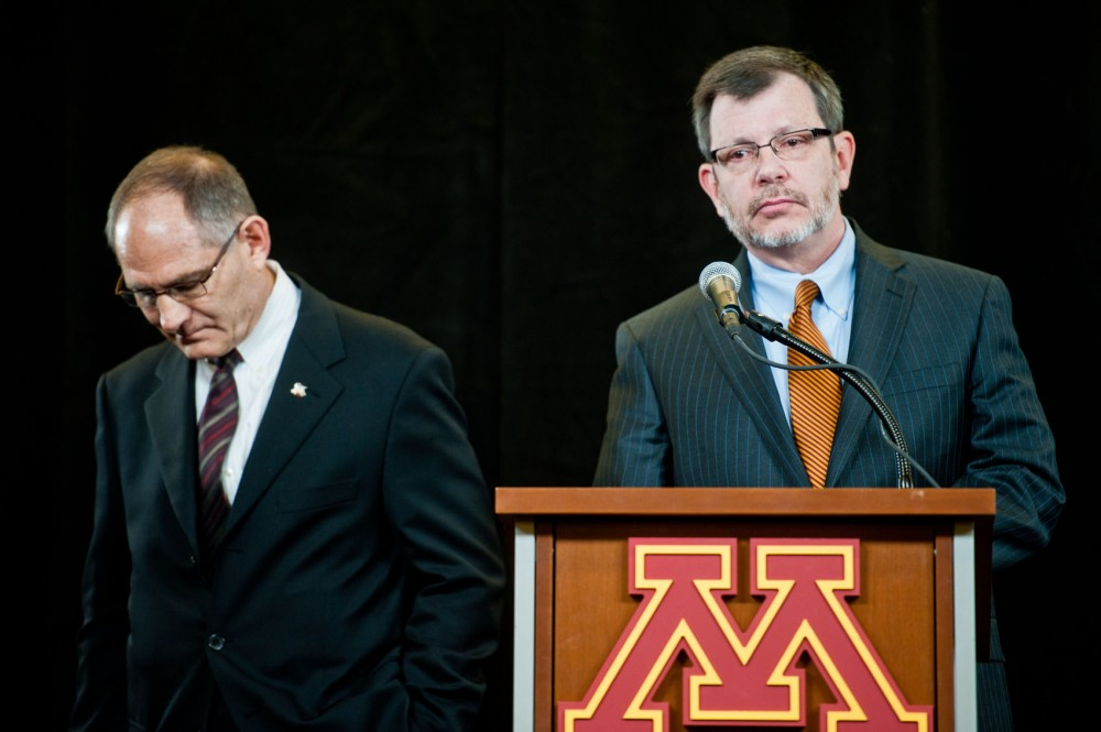 Minnesota athletic director Joel Maturi, left, announced he would step-down from his position during a press conference with University President Eric Kaler, right, on Thursday, Feb. 2, 2012, at TCF Bank Stadium.