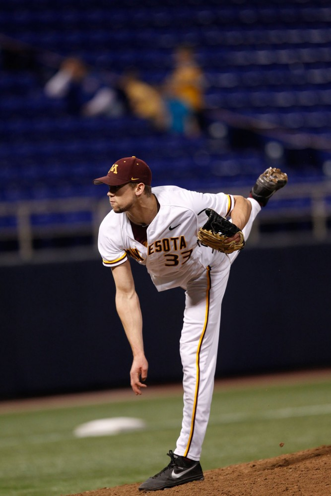 Former Minnesota pitcher Drew Ghelfi throws the ball against NDSU on March 27, 2013 at the Metrodome.