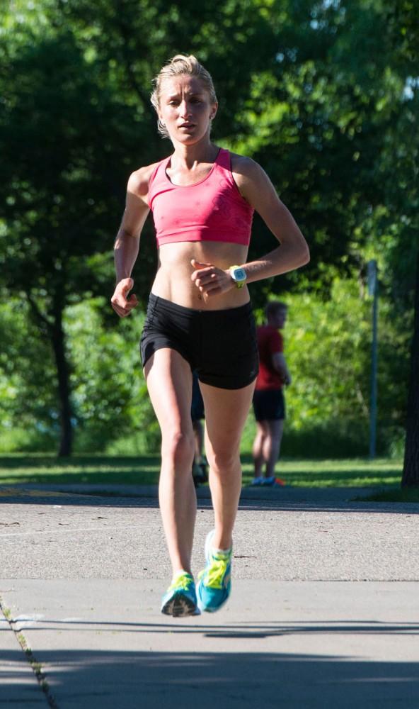 Former Gopher Stephanie Price runs around Lake Calhoun on June 17, 2013, in Minneapolis.