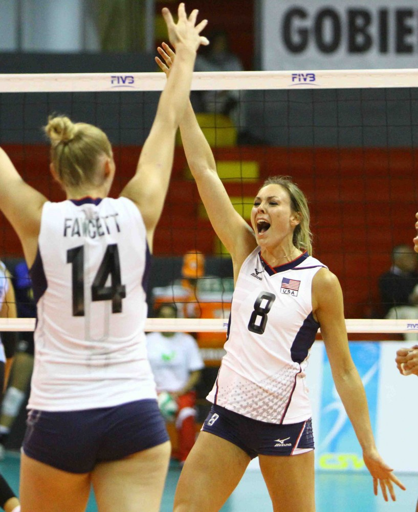 Former Gophers middle blocker Lauren Gibbemeyer, right,  celebrates a key point for the U.S. versus Argentina.