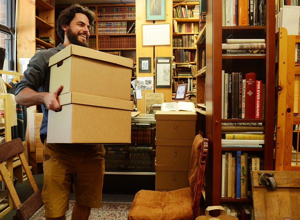 The Book House stock manager Kevin Sell moves boxes that will be brought to other locations on May 26, 2013, in Dinkytown.