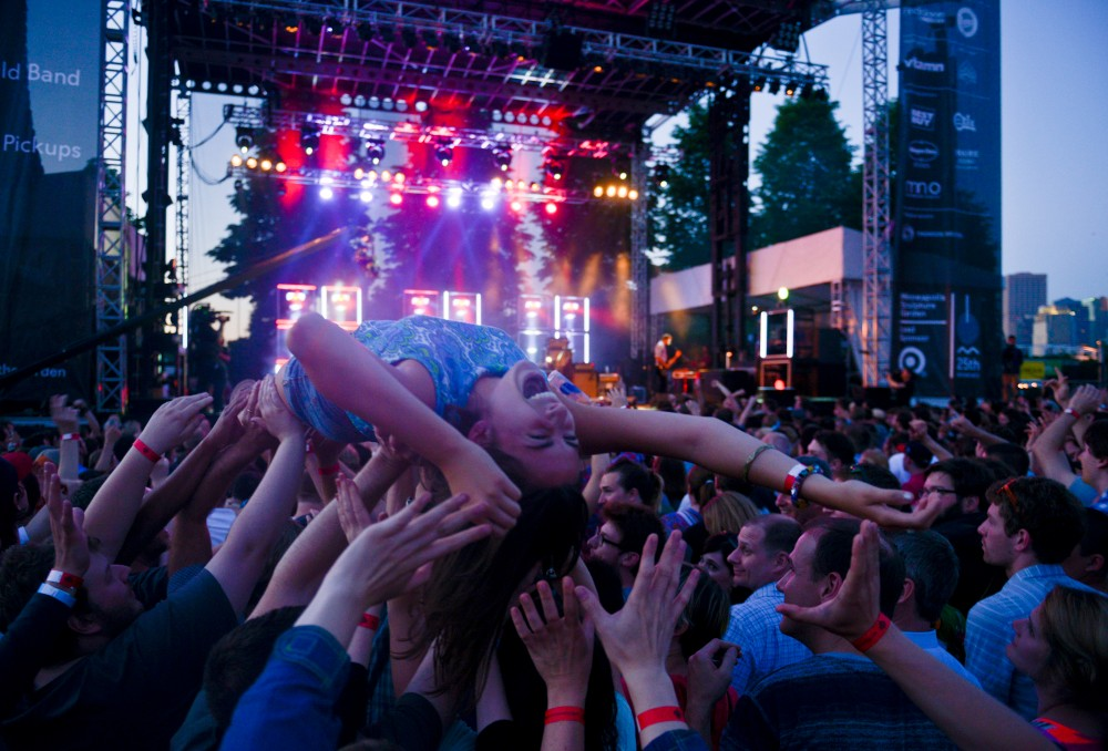 A Rock the Garden attendee crowd surfs during Metric's set on Saturday June 15th, 2013.