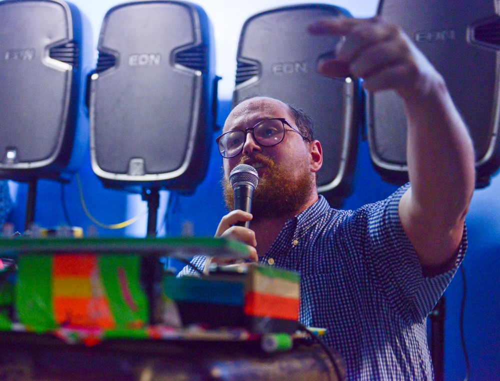Dan Deacon performs live in the parking garage of The Walker Art Center during the Rock the Garden concert on Saturday June 15th, 2013. Attendees sought shelter from the rainstorm that overshadowed the the beginning of the festival.