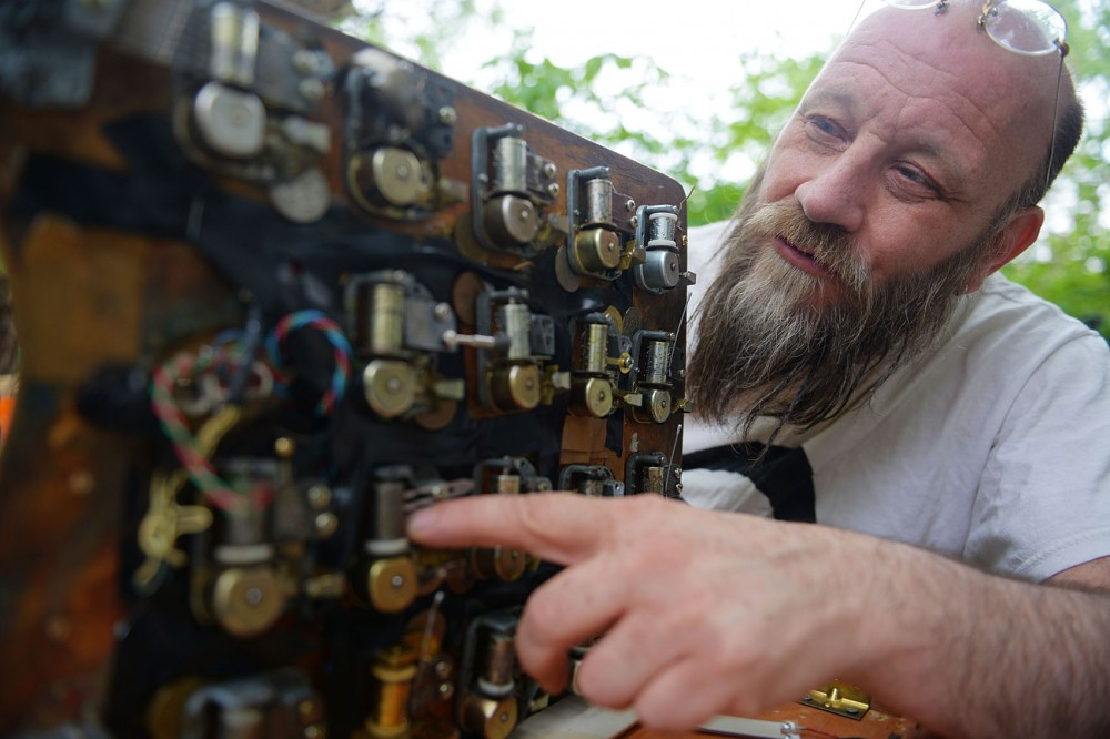 Paul Metzger winds up the knobs on his handmade music machine that is made up of 21 windup music boxes altered to orchestrate unique sounds. Metzger will be performing at the International Noise Conference at the Hexagon Bar on June 6.