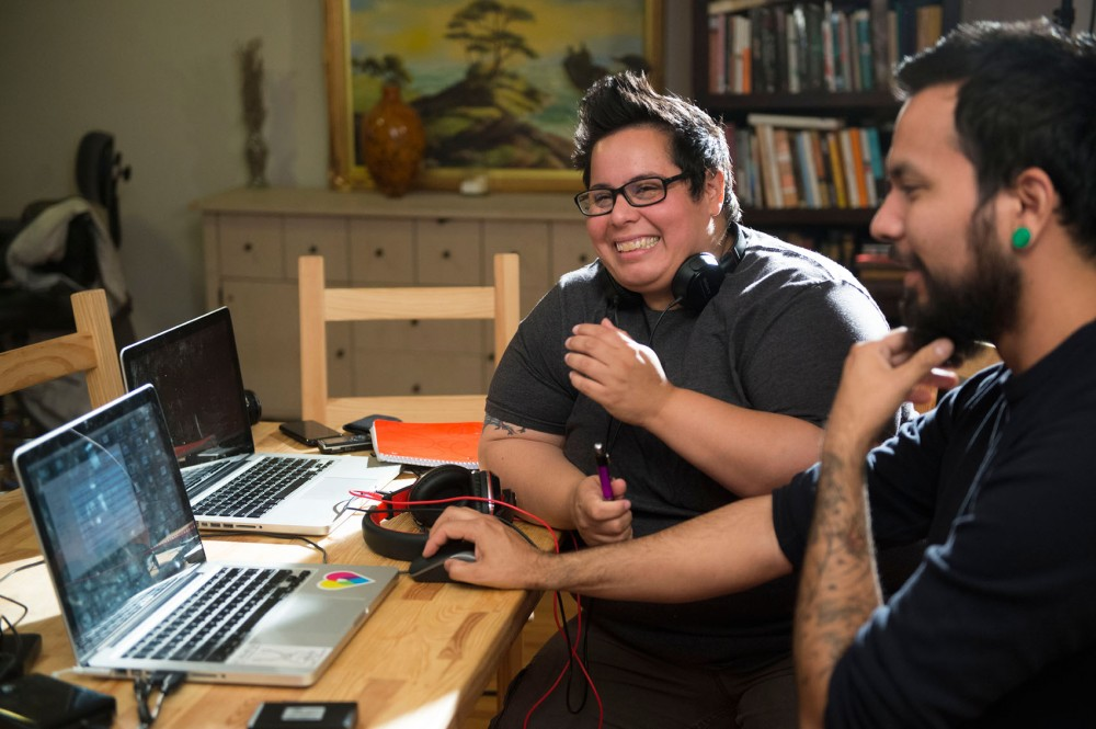 Minneapolis teacher Jen Arzayus, left, and lead editor Zane Spang explain the process of shooting and editing a documentary on Thursday, June 6, 2013, at Arzayus's Minneapolis home. Her documentary