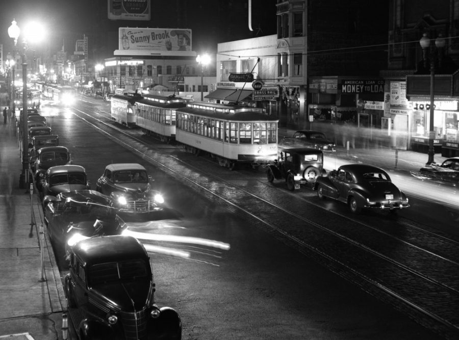 Augie's Bar lies behind the streetcars on Hennepin Avenue in this 1949 photo.