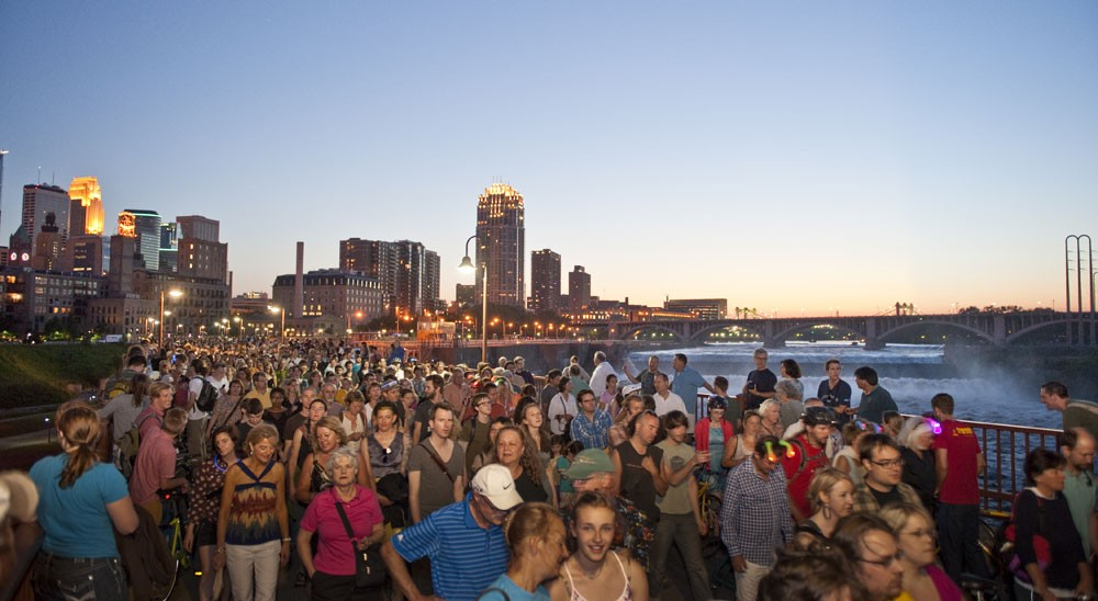 Attendees crowd the Stone Arch Bridge during last year's Northern Spark.