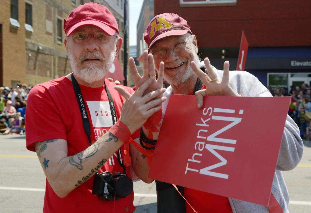 A couple shows off their rings in the Pride Parade on June 30, 2013, in Minneapolis. Many same-sex couples in Minnesota will be affected by the repeal of the Defense of Marriage Act by the Supreme Court and the passing of a marriage equality bill in Minnesota.