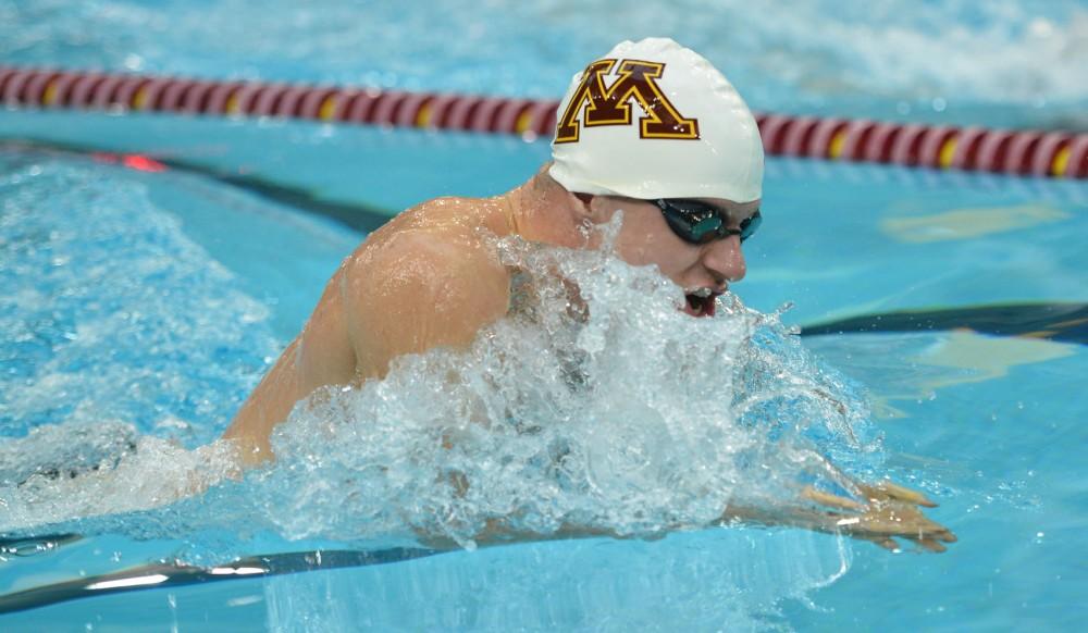 Minnesota's Derek Toomey swims in the men's 100-yard breaststroke during the Minnesota Challenge on Saturday, Feb. 9, 2013, at the University Aquatic Center.