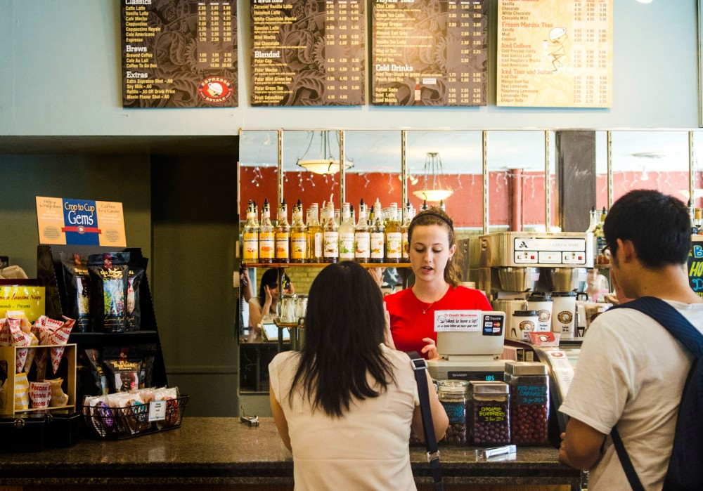 Espresso Royale barista Natalie Miller helps a customer on Sunday, July 7, 2013. Espresso Royale is currently looking for a new location in Dinkytown after its space was bought by Green Mill Restaurants last July.