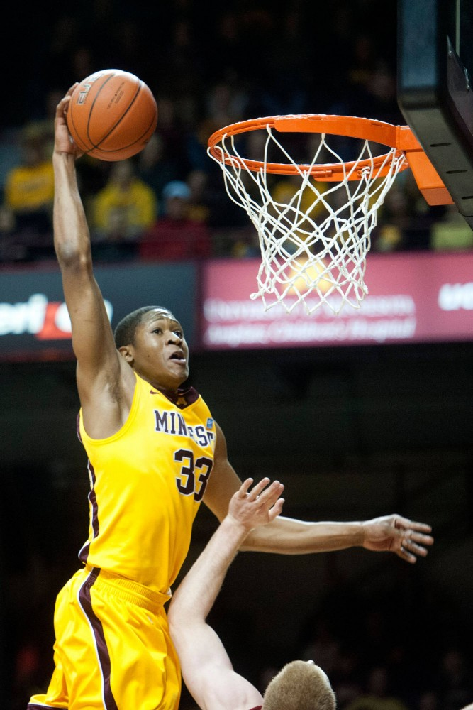 The Gophers' Rodney Williams slams in two points during a game against Nebraska Saturday, March 3 at Williams Arena. Williams scored a career-high 24 points in Wednesday's 78-72 win against Middle Tennessee State.