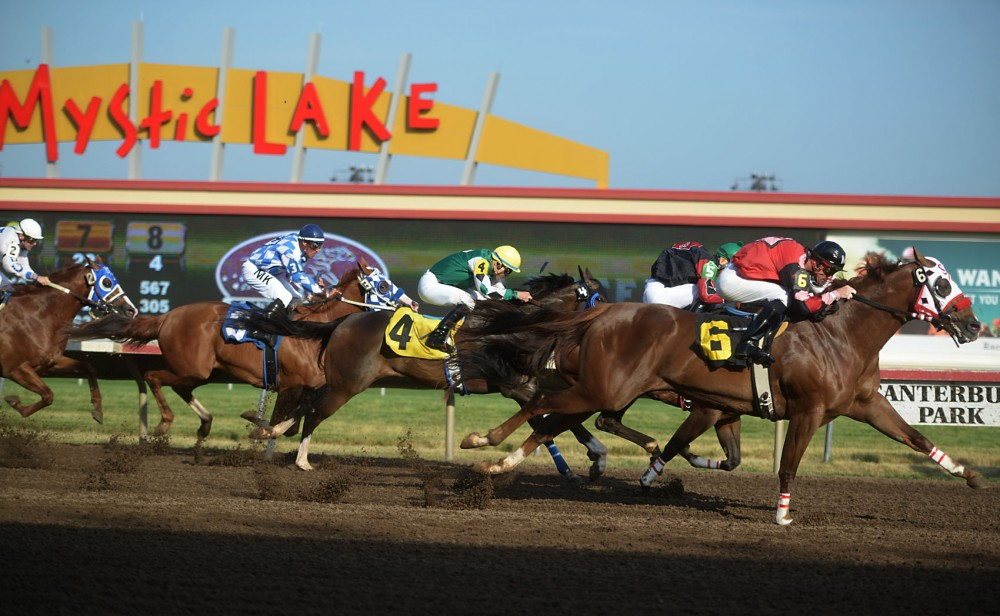 Jockeys race their horses during the first race at Canterbury Park on Friday, July 12, 2013,.