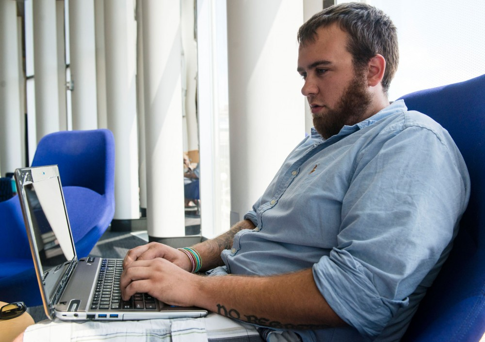 Student veteran Zach Benson works on a paper between work and class on July 15, 2013, in the Science Teaching and Student Services building.