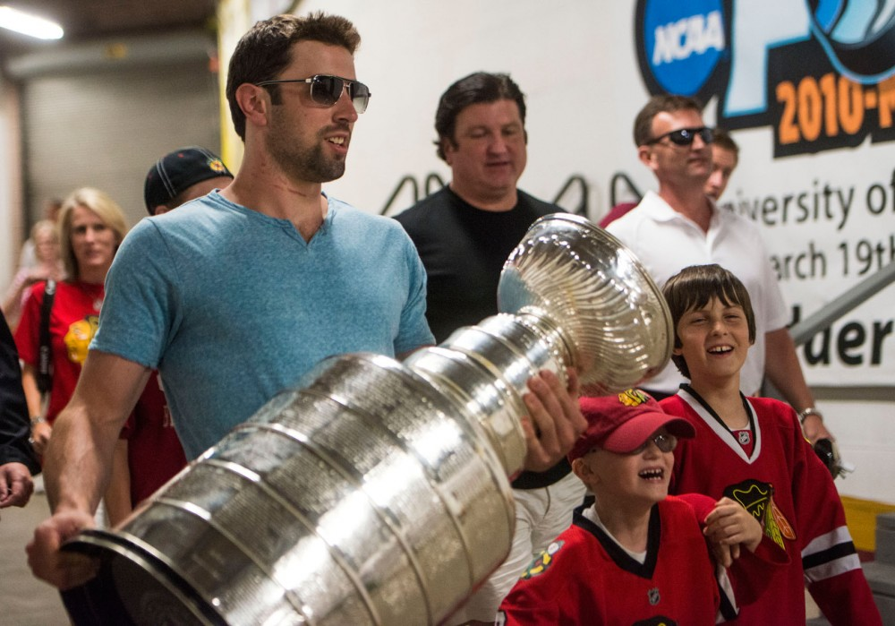 Blackhawks defenseman and former Gopher hockey player Nick Leddy holds the Stanley Cup on July 12, 2013, at Mariucci Arena. Leddy brought the cup to various locations around the Twins Cities area during his two days with the trophy.