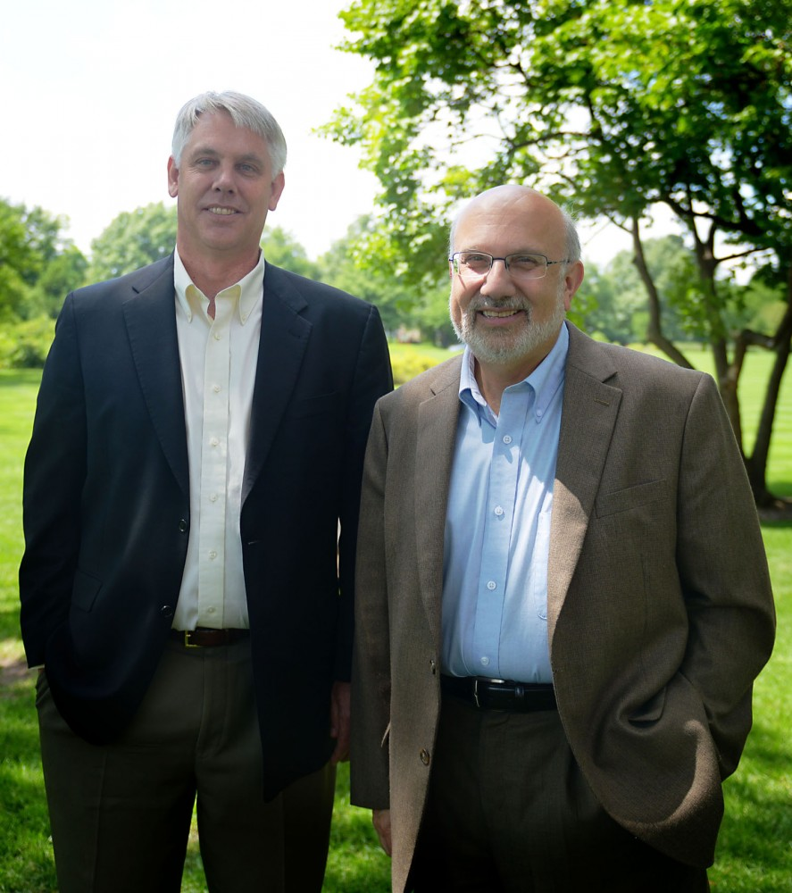 Brian Buhr, recently named interim dean of the College of Food, Agricultural and Natural Resource Science, stands with current Dean Allen Levine outside St. Paul Campus' Haecker Hall on Monday July 22nd, 2013.