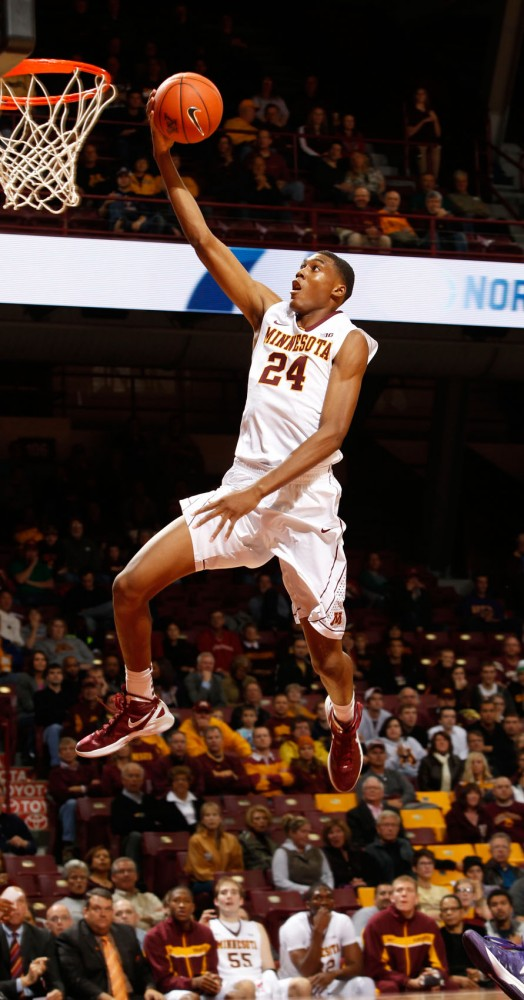 Gophers'  forward Charles Buggs goes up for a layup on Thursday, Nov. 1, 2012. Buggs recently gained -- pounds in the off season and will play with the Gophers this season.