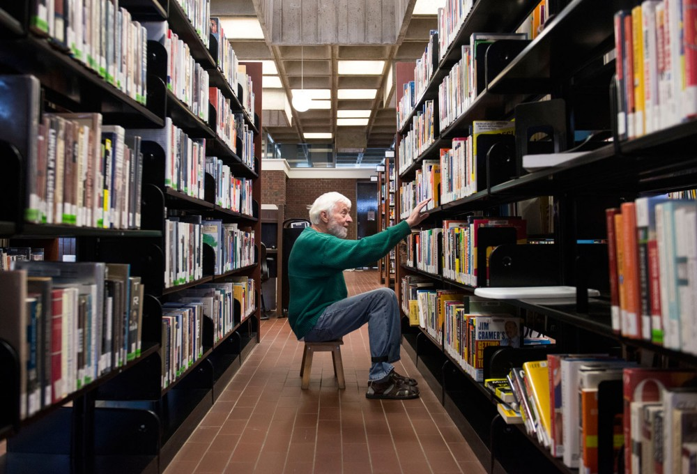 Library volunteer Paul Caspersen organizes shelves at the Southeast Library on Saturday, Aug. 3, 2013, near Dinkytown. When the inspection results of the building, designed by former University architecture professor Ralph Rapson, become public in the fall, the library could stay in its current location or move to a new neighborhood.