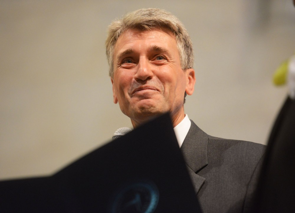 Mayor R.T. Rybak smiles as the crowd cheers between wedding ceremonies just after midnight on August 1, 2013, at Minneapolis City Hall. Margaret Miles and Cathy ten Broeke, of Minneapolis became the first legally married same-sex couple in Minnesota.