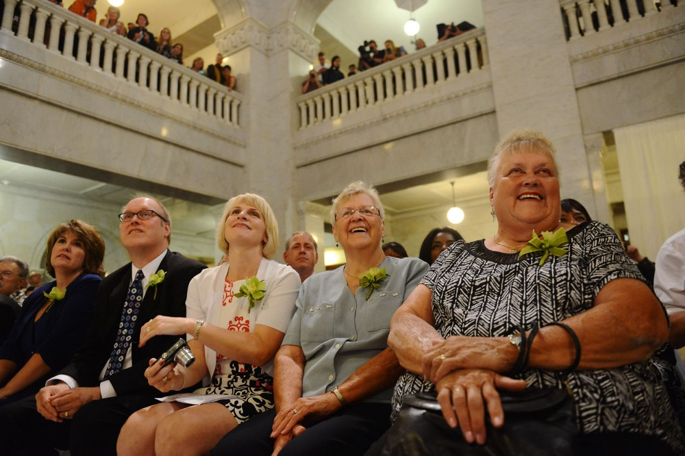 Doris Isaacson, right, mother of Jeff Isaacson, and Doris Qually (SP?), center, mother of Al Giraud, smile as Mayor Rybak begins the wedding ceremony for their sons August 1, 2013, at Minneapolis City Hall. Isaacson and Giraud became the second legally married same-sex couple in Minnesota immediately afterward.