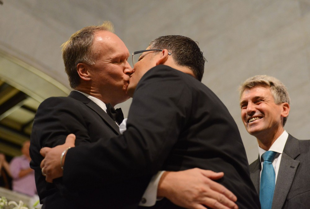 Jeff Isaackson, left, and Al Giraud, of Minneapolis, kiss after Mayor R.T. Rybak pronounces them legally married August 1, 2013, at Minneapolis City Hall. Isaackson and Giraud became the second legally married same-sex couple in Minnesota.