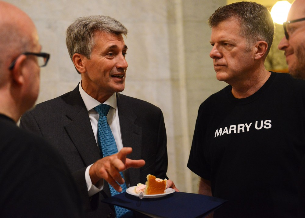 Mayor R. T. Rybak, center, talks with John MacClean, right,  of the Minneapolis Gay Mens Chorus, August 1, 2013, at Minneapolis City Hall. The chorus has been performing and advocating for marriage equality for years.