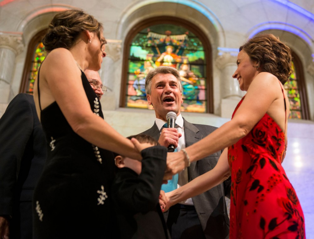 Minneapolis Mayor R. T. Rybak marries Margaret Miles and Cathy ten Broeke, with their son between their arms, at Minneapolis City Hall Wednesday at midnight.