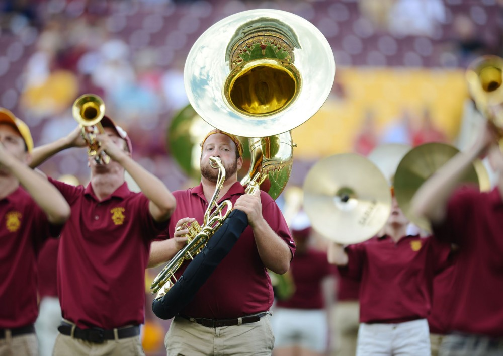 Kinesiology senior Ian Almquist plays a sousaphone in the marching band during Thursday's football game against Nevada-Las Vegas at TCF Bank Stadium.
