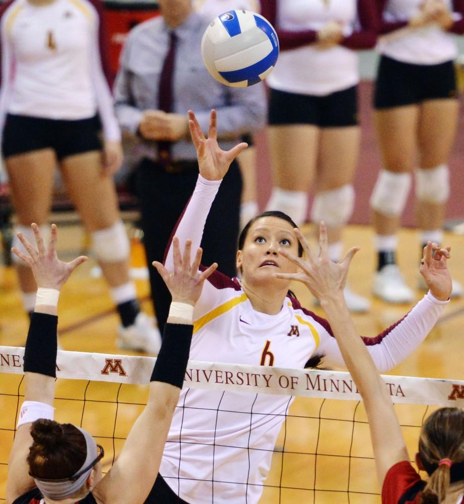 Minnesota middle blocker Tori Dixon tips the ball over the net against Nebraska on Nov. 16, 2012, at the Sports Pavilion.