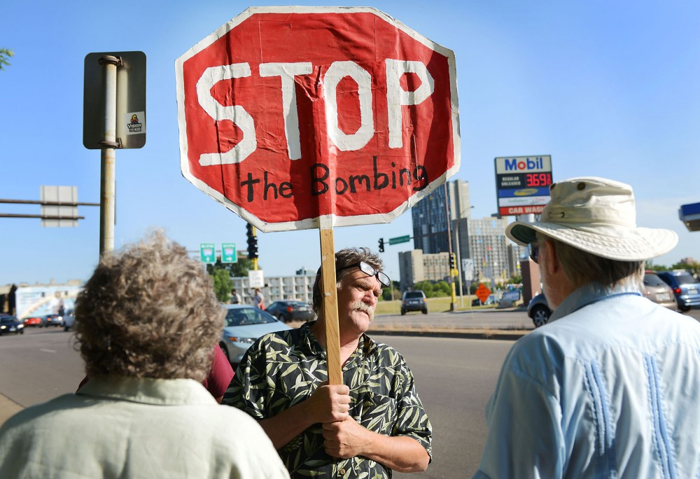 Apple Valley resident Ross Rowley rallies against U.S. military intervention in Syria on Tuesday in Minneapolis outside U.S. Sen. Amy Klobuchar's office.
