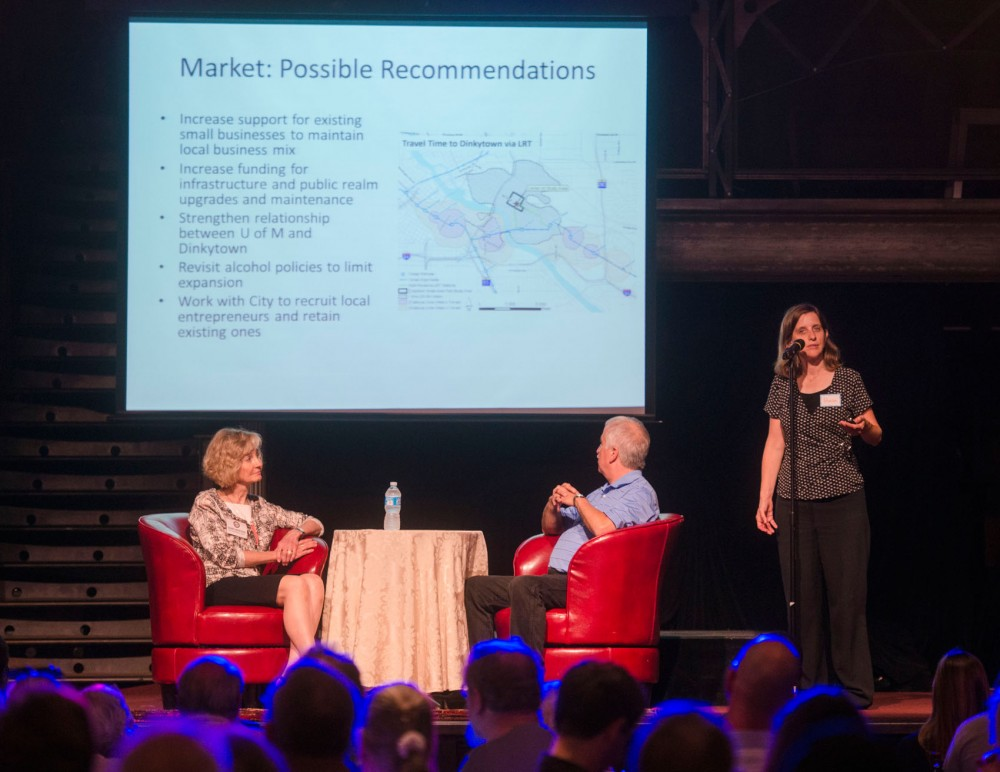 Principle planner of Minneapolis Haila Maze speaks to an audience of about 150 in regards to the Dinkytown small area plan while Third Ward City Councilwoman Diane Hofstede and Dinkytown business Associate President Scott Johnson sit on stage, Tuesday evening at Varsity Theater.