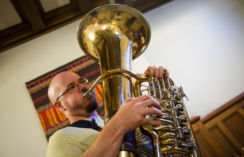 "The Copper Street Brass Quintet's trombone player Nick Adragna practices with the rest of the band on Monday, Sept. 16, 2013, at Hennepin Avenue United Methodist Church. ""That 80's Show"