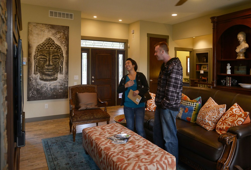 St. Paul residents Pa, right, and David Otterness talk about building their dream home at the the new University