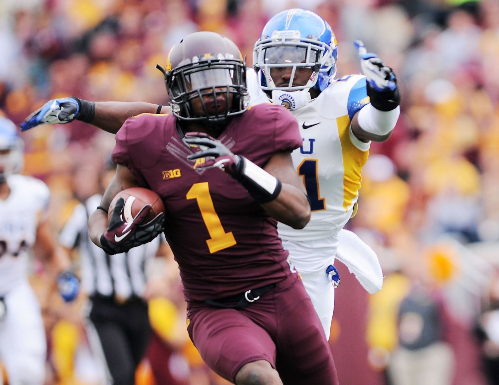 Minnesota wide receiver KJ Maye avoids a tackle from San Jose State cornerback Bene Benwikere on Saturday, Sept. 21, 2013 at TCF Bank Stadium.