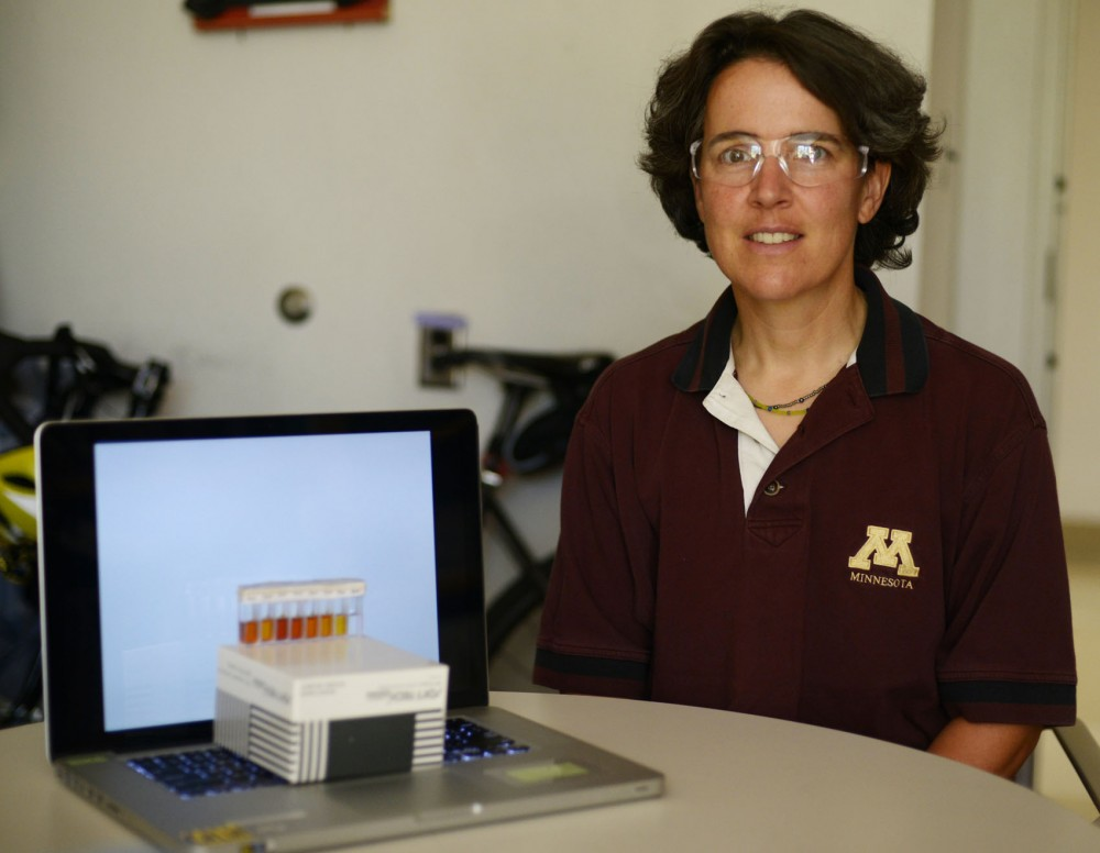 Associate Professor of Chemistry Lee Penn in her office, Tuesday morning. Peen works with former University student Eric Kehoe to develop a new technique of using cells phone to analyze solutions, rather than spectrometers.