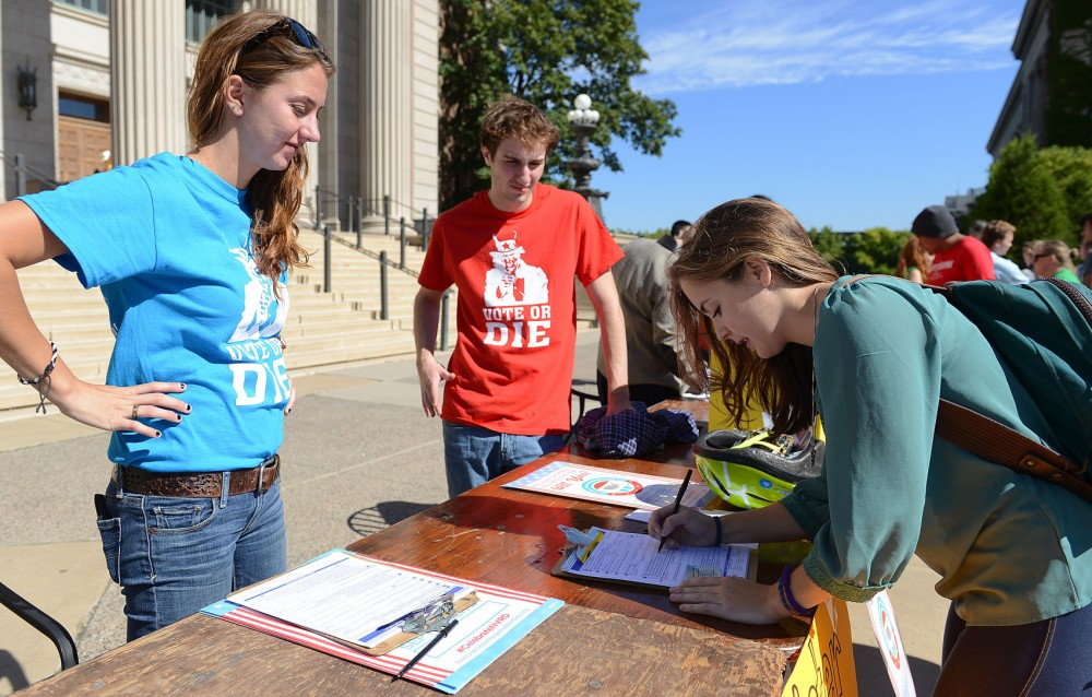 Senior Tatiana Hakanson, right, registers to vote at