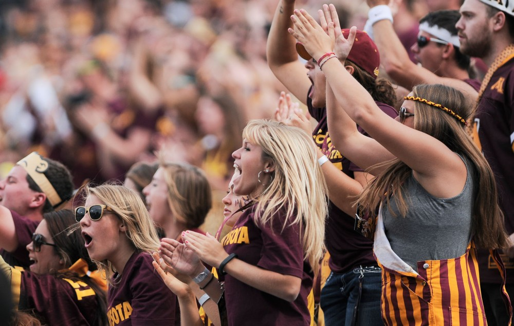 Students cheer for the Gophers against West Illinois on Saturday at TCF Bank Stadium.