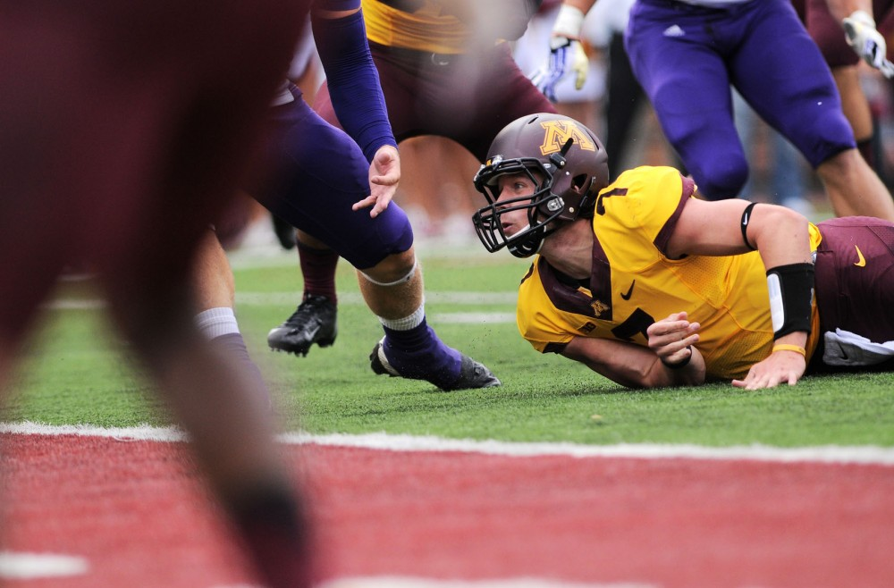 Minnesota quarterback Mitch Leidner looks up after losing the ball against Western Illinois on Saturday at TCF Bank Stadium.