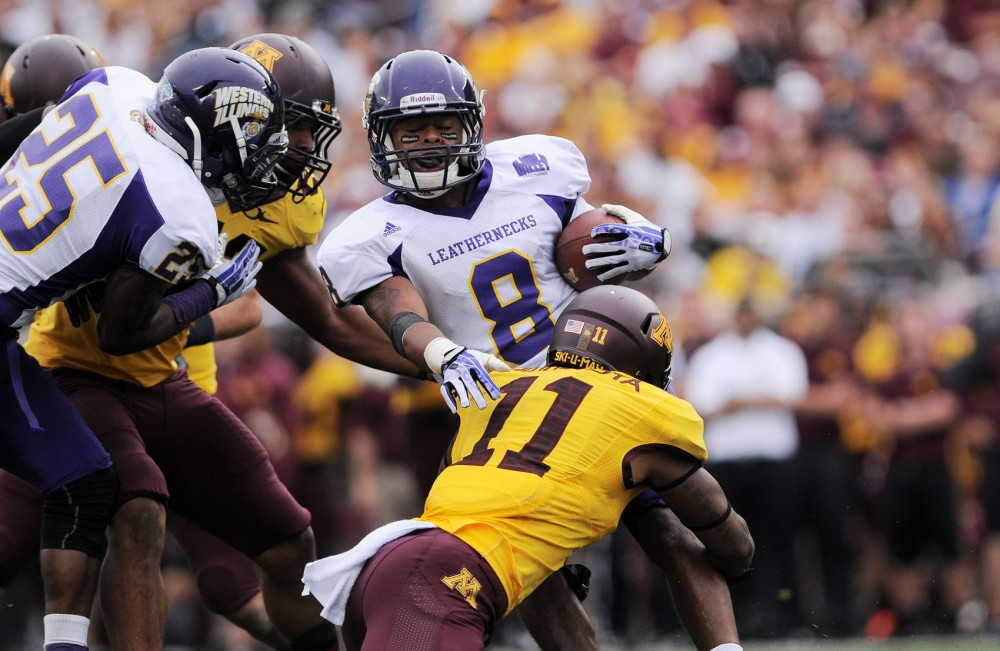 Minnesota defensive back Antonio Johnson tackles Western Illinois defensive back Antoine Ford on Saturday at TCF Bank Stadium.