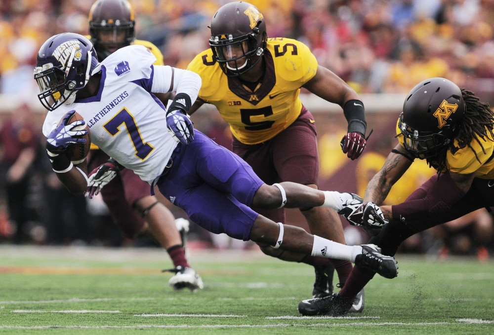 Western Illinois wide receiver Lance Lenoir Jr falls after being tackled by the Minnesota gophers on Saturday at TCF Bank Stadium.
