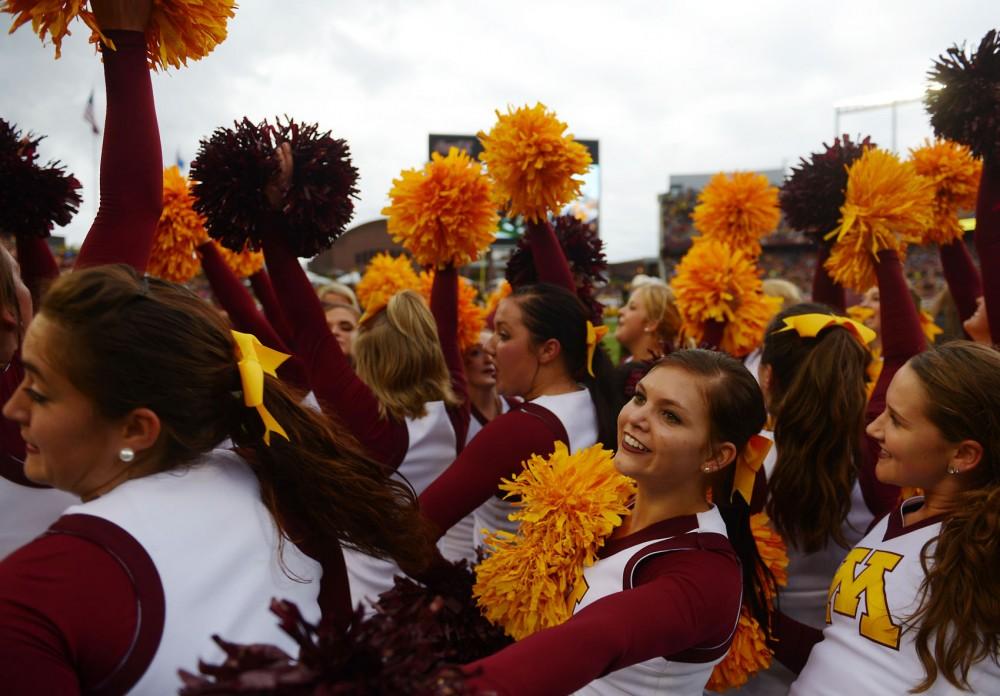 Minnesota cheerleaders dance during Saturdays game against Iowa on Saturday at TCF Bank Stadium.
