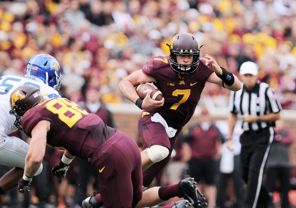 Minnesota quarterback Mitch Leidner runs past San Jose State on Saturday at TCF Bank Stadium. Leidner scored four rushing touchdowns during the game.