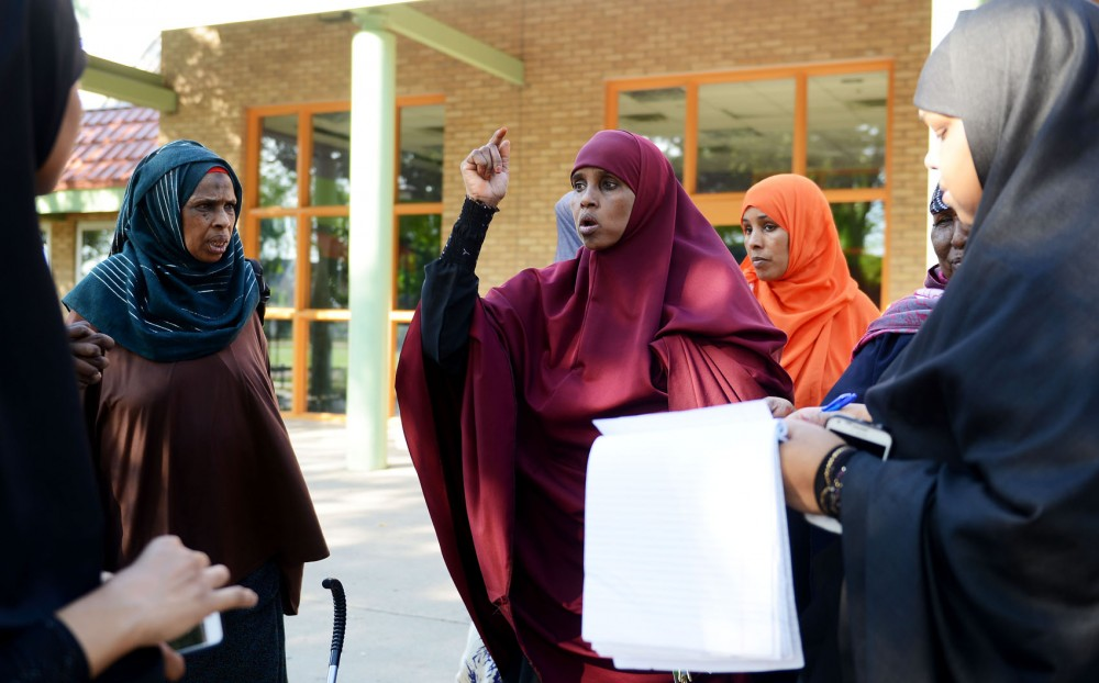 Shamso Hashi, center, explains her complaints with the living conditions at Riverside Plaza to other residents of Riverside Plaza on Saturday, Sept. 7, 2013. The Confederation of Somali Community in Minnesota will meet with residents on Friday to hear their concerns.