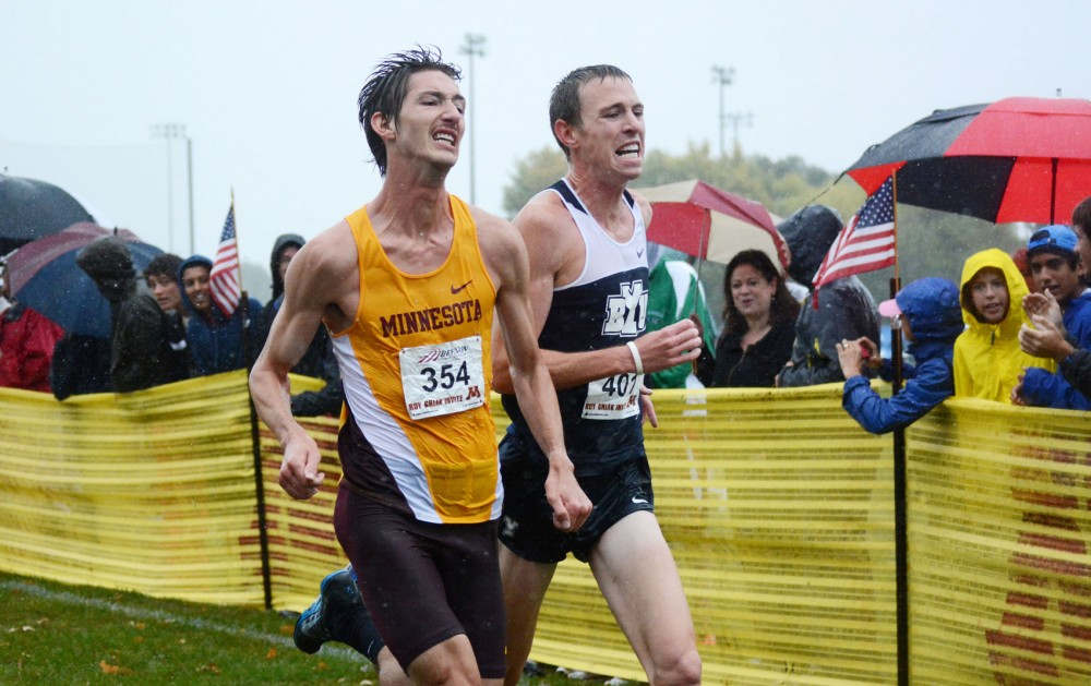 Minnesota senior John Simons outruns Brigham Young University's Jason Witt at the finish of the men's Division I Roy Griak Invitational on Saturday at Les Bolstad Golf Course. Simons finished in 6th place.
