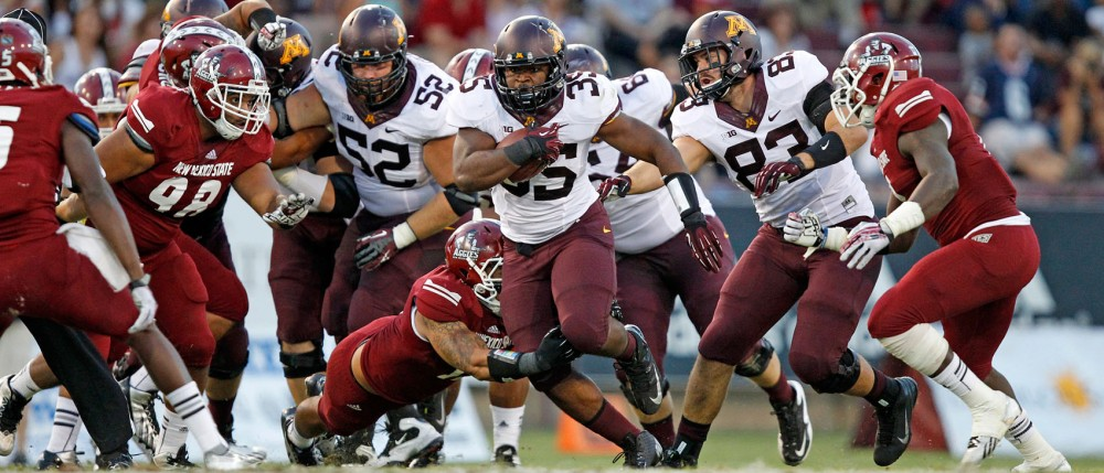 Rodrick Williams Jr. breaks a tackle against New Mexico State on Saturday in Las Cruces, N.M. Williams Jr. had 16 carries for 148 yards in the Gophers 44-21 win.