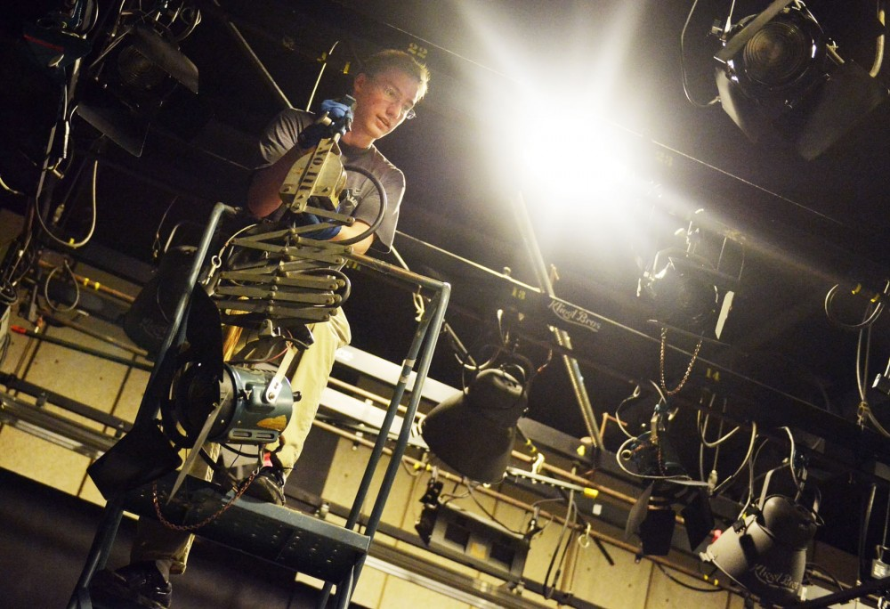 Communications junior Marty Davis fixes the lighting in preparation for a film class on Thursday, Sept. 5, 2013, at Rarig Center.